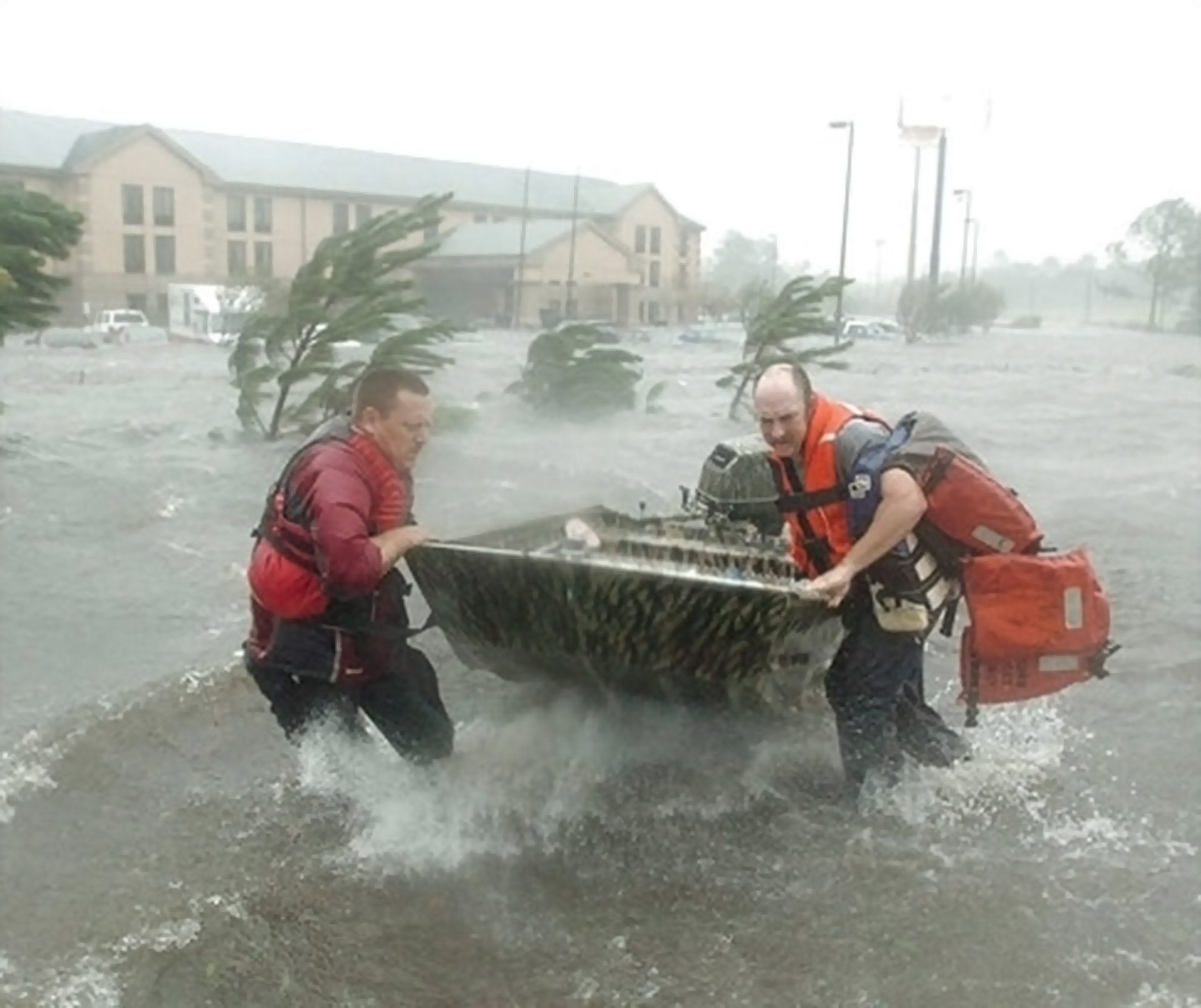 Fire and rescue personnel launch a boat amid floodwaters from Hurricane Katrina, as they head out to rescue a family Tuesday, Aug. 29, 2005, outside a hotel in Pascagoula, Miss. (AP Photo/The Tampa Tribune, Michael Spooneybarger)