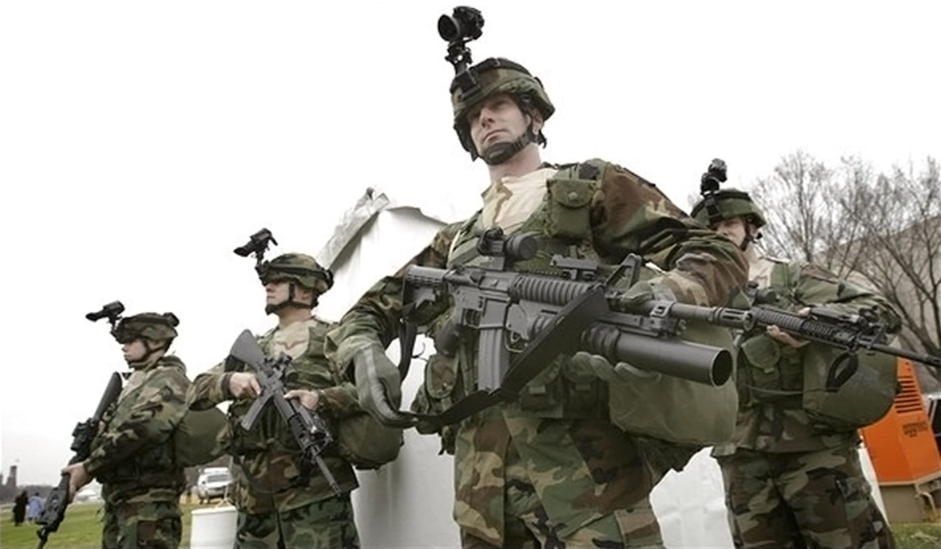 U.S. Army Sgt Jeremy McClellan of Borger, Texas, brandishes his M4 firearm equipped with a M203 grenade launcher during a show of the security in place for the Presidential Inauguration, in Washington, January 11, 2005. Washington is preparing for its first presidential inauguration since the September 11, 2001 attacks and Department of Homeland Security Secretary Tom Ridge said security at the January 20 event will be unprecedented. REUTERS/Jason Reed