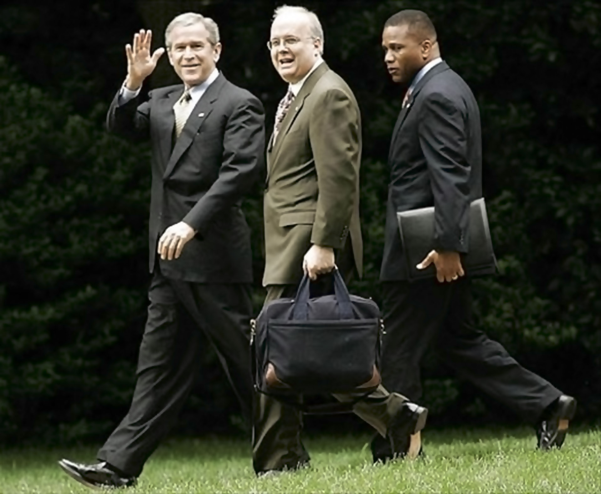 WASHINGTON - JULY 14:  (L-R) U.S. President George W. Bush, Deputy Chief of Staff Karl Rove, and Assistant to the President for Domestic Policy Claude Allen walk from the Oval Office across the South Lawn of the White House toward Marine OneJuly 14, 2005 in Washington, DC. Bush is leaving to make remarks at the Indiana Black Expo Corporate Luncheon in Indianapolis, Indiana. (Photo by Chip Somodevilla/Getty Images)  *** Local Caption *** George W. Bush;Karl Rove;Claude Allen