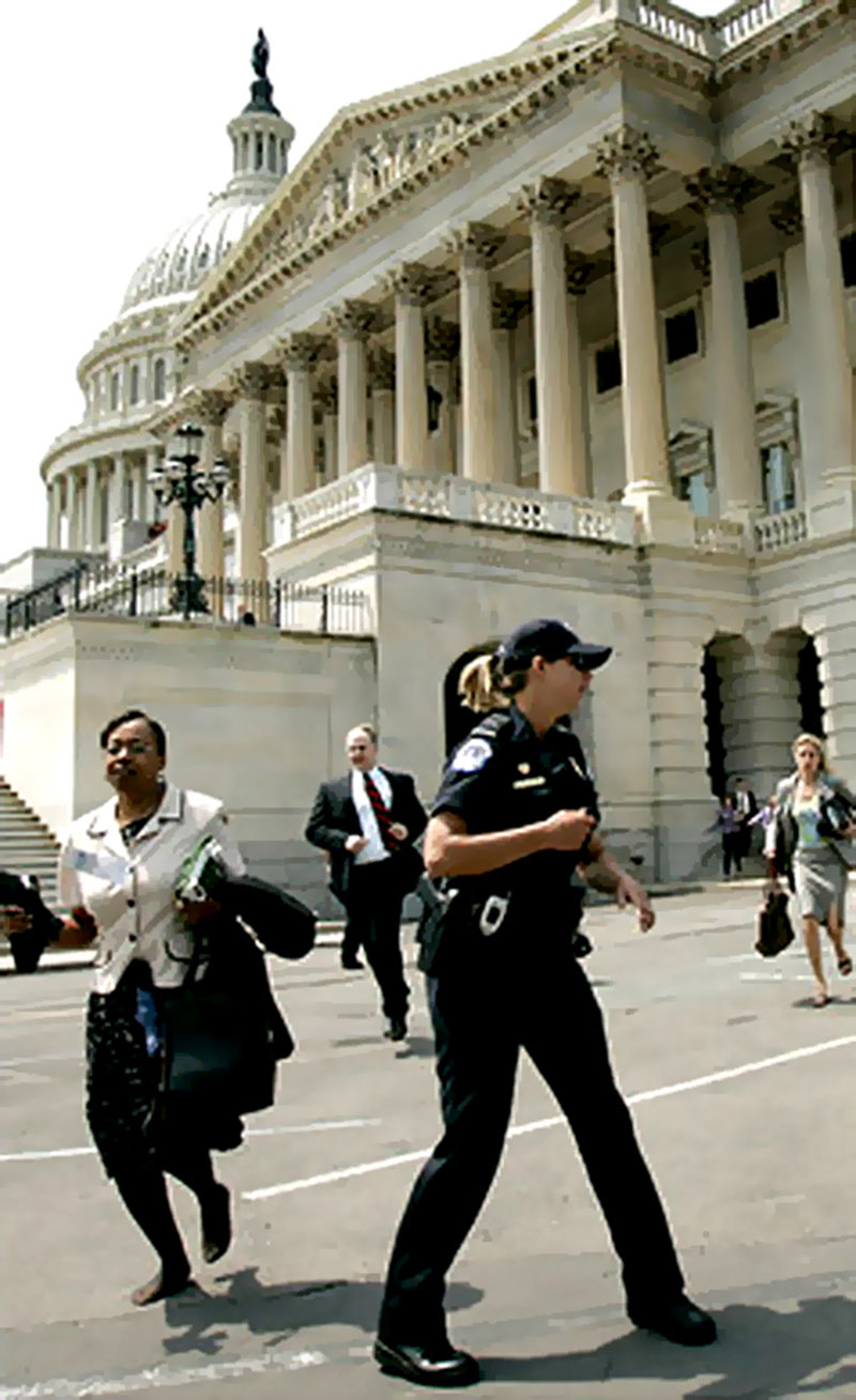 WASHINGTON - MAY 11:  U.S. Capitol Police evacuate the U.S. Capitol May 11, 2005 in Washington, DC. The Capitol and White House where evacuated after an apparent threat from the air.  (Photo by Brendan Smialowski/Getty Images)