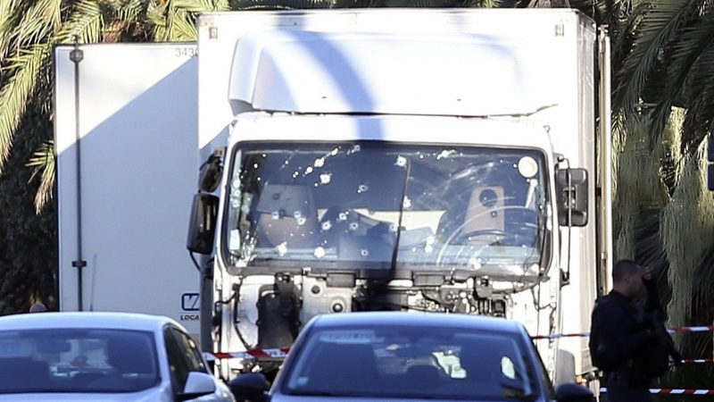 The truck which slammed into revelers late Thursday, July 14, is seen near the site of an attack in the French resort city of Nice, southern France, Friday, July 15, 2016.   France has been stunned again as the large white truck mowed through a crowd of revelers gathered for a Bastille Day fireworks display in the Riviera city of Nice.  (AP Photo/Luca Bruno)