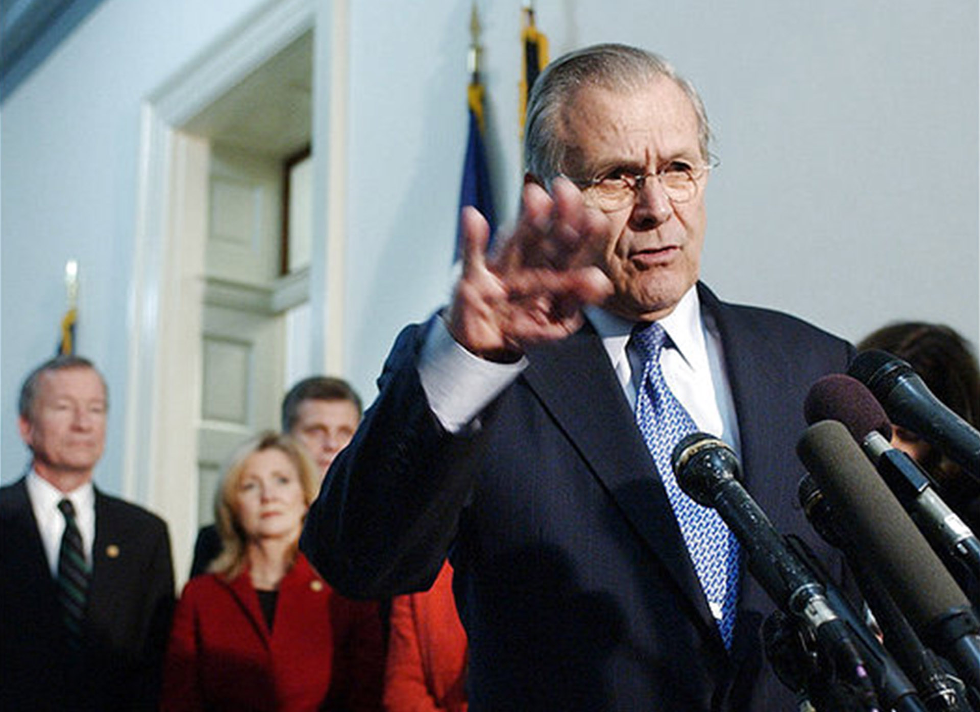Defense Secretary Donald Rumsfeld talks to reporters following a meeting with members of Congress on Capitol Hill Thursday, Dec. 8, 2005, on the war in Iraq.   Rumsfeld on Thursday raised the possibility of reducing U.S. troop levels in Iraq next year below the 137,000 baseline.   (AP Photo/Dennis Cook)