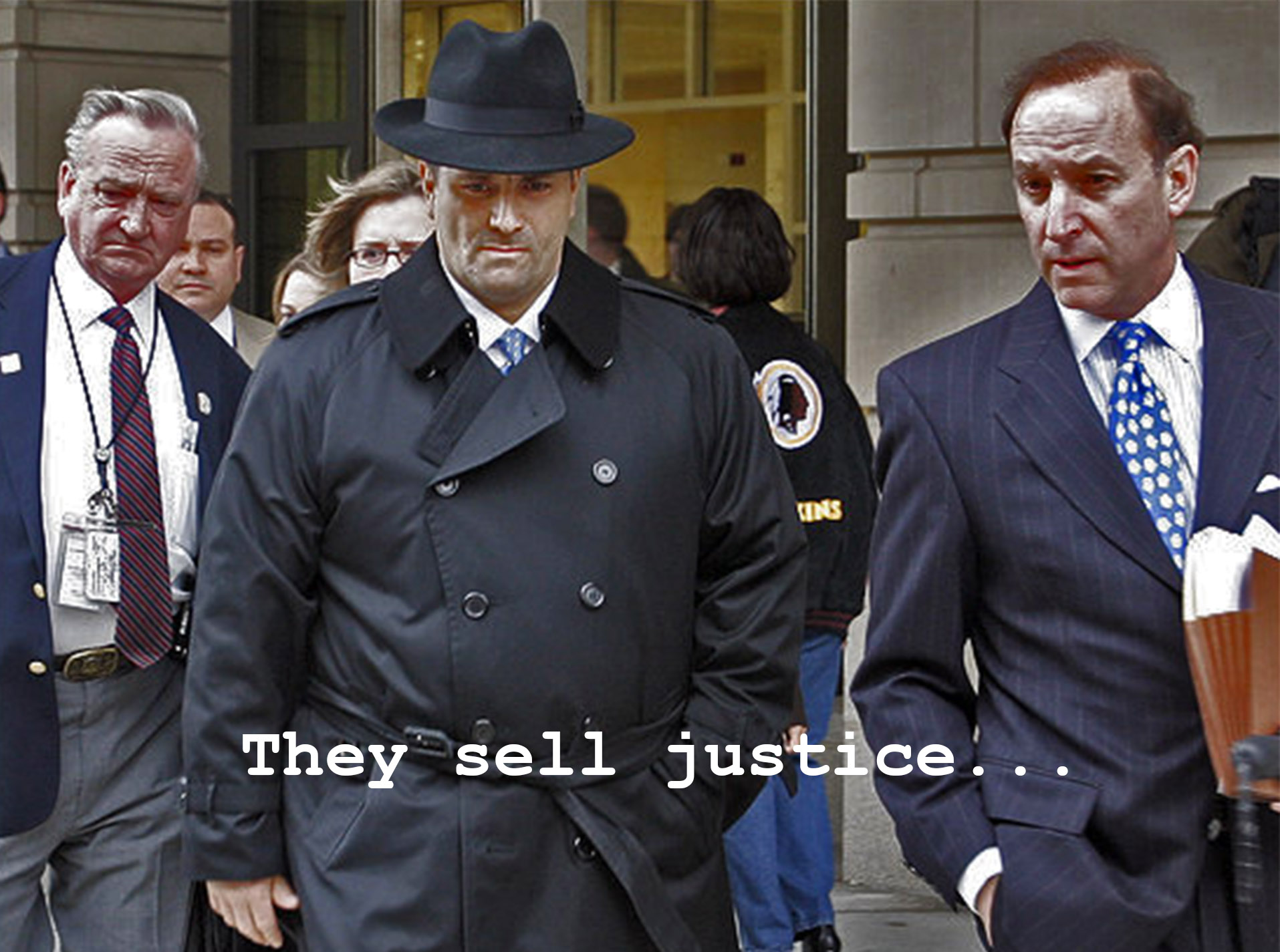 Jack Abramoff, center, leaves Federal Court in Washington Tuesday, Jan. 3, 2006. The once-powerful lobbyist pleaded guilty Tuesday to federal charges of conspiracy, tax evasion and mail fraud, agreeing to cooperate with prosecutors investigating influence peddling that has threatened powerful members of the U.S. Congress. At right is his attorney Abbe Lowell.    (AP Photo/Gerald Herbert)