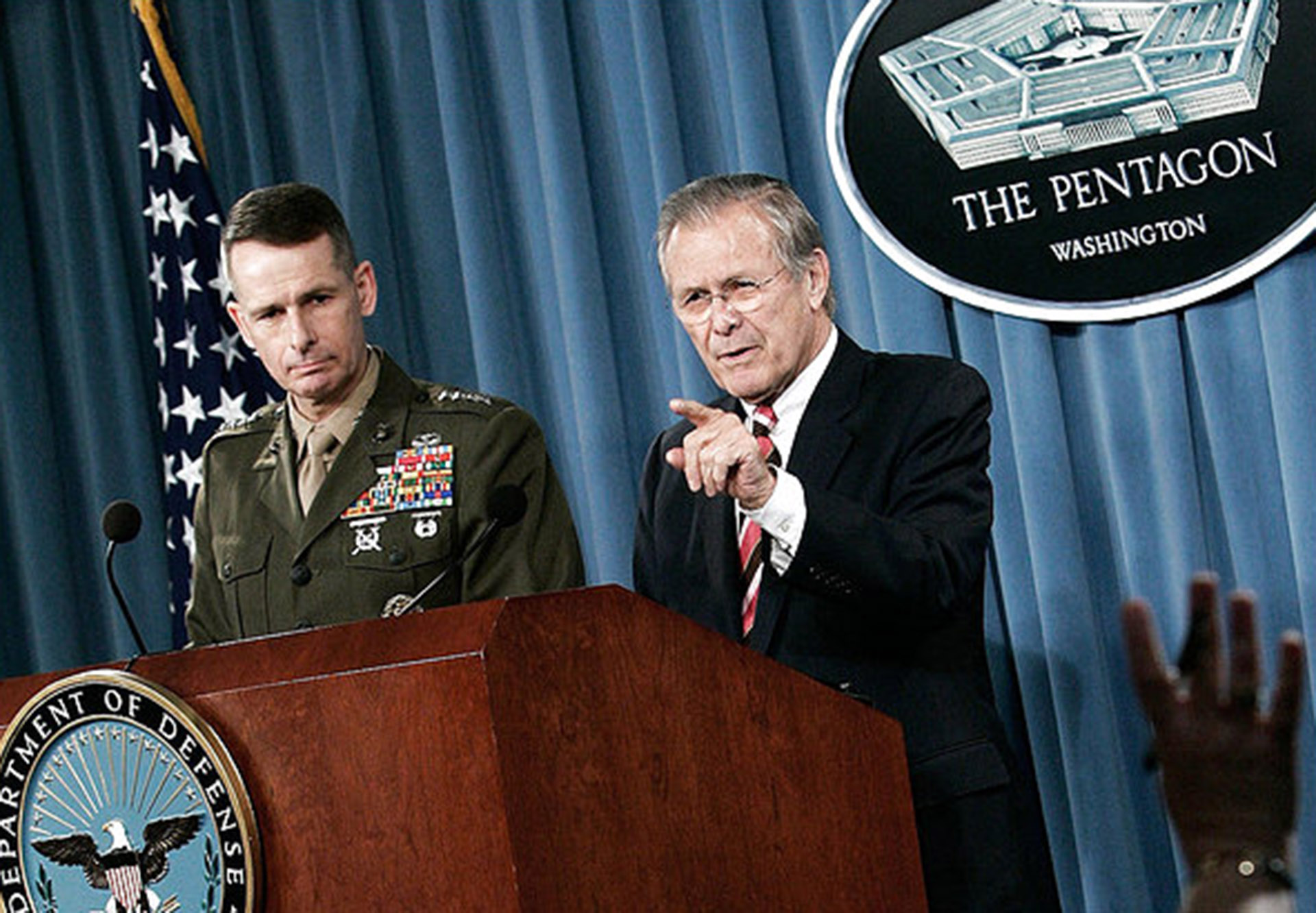 ARLINGTON, VA - APRIL 11:  U.S. Secretary of Defense Donald Rumsfeld (R) speaks as Chairman of Joint Chiefs of Staff Gen. Peter Pace (L) listens during a news briefing at the Pentagon April 11, 2006 in Arlington, Virginia. Rumsfeld refused to speculate whether there will be a military attack on Iran.  (Photo by Alex Wong/Getty Images) *** Local Caption *** Donald Rumsfeld;Peter Pace