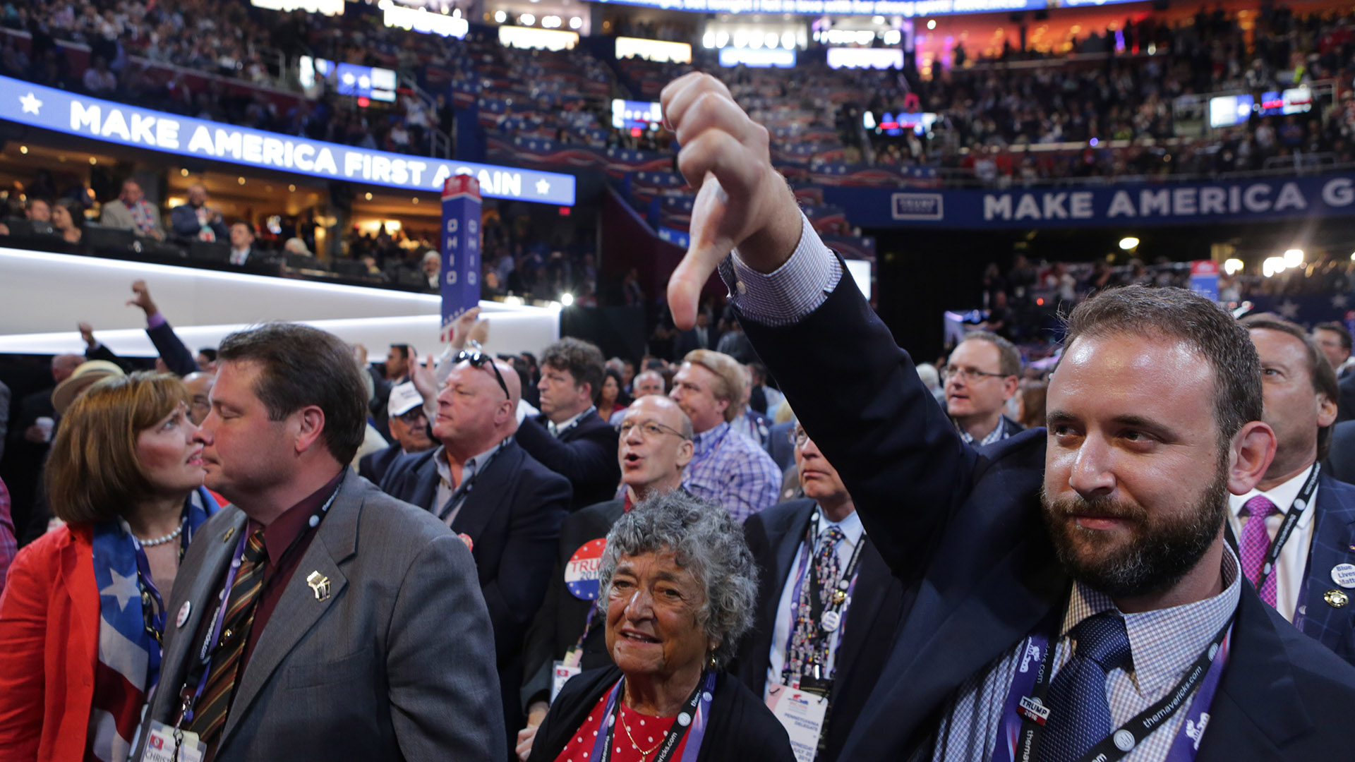 Seth Kaufer gives a thumbs down during Sen. Ted Cruz's speech on day three of the Republican National Convention, at the Quicken Loans Arena in Cleveland, July 20, 2016. Cruz spoke to mounting boos and chants of ?Keep your pledge!? as he declined to explicitly endorse Donald Trump. (Sam Hodgson/The New York Times)