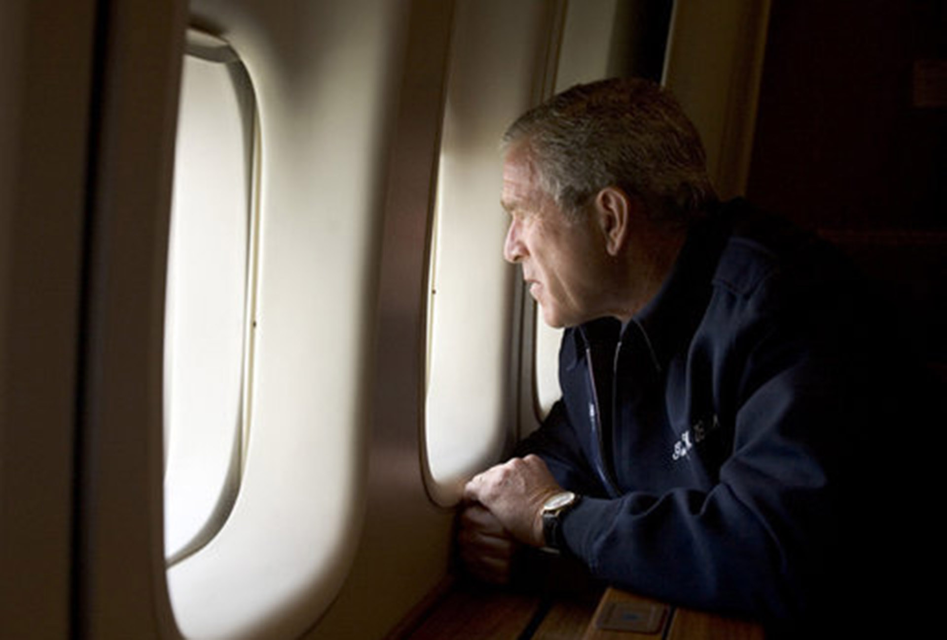 GWB: President George W. Bush looks out over devastation from Hurricane Katrina as he heads back to Washington DC Wednesday, Aug. 31, 2005, aboard Air Force One. White House photo by Paul Morse