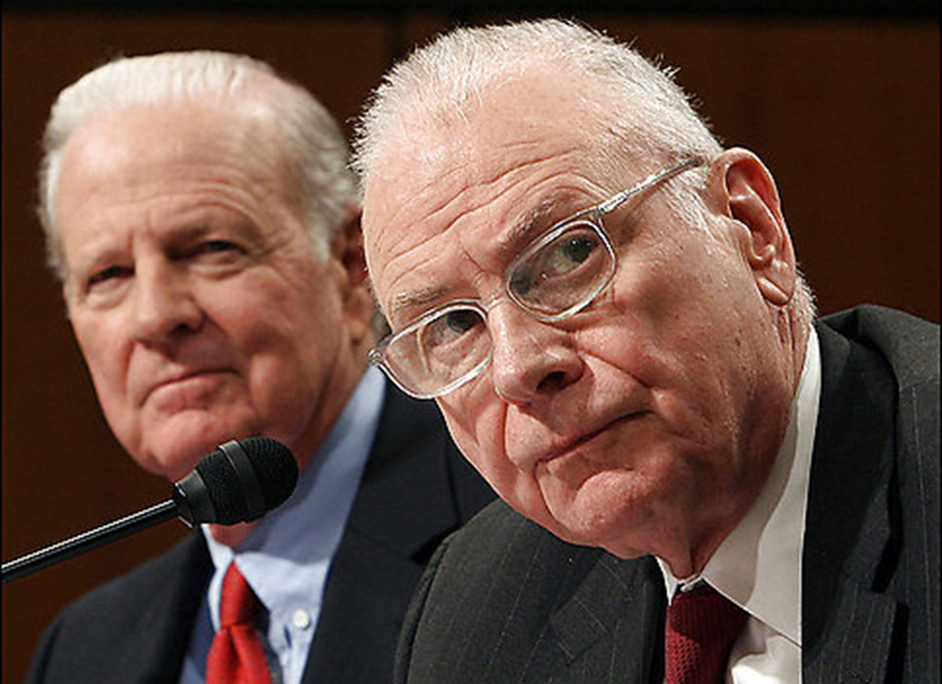 Iraq Study Group co-chairs James A. Baker III, left, and Lee Hamilton, testify during a hearing of the Senate Armed Services Committee, Thursday, December 7, 2006, in Washington, D.C. Baker said President George W. Bush gave him permission to approach the Iranian government about its willingness to help strengthen Iraq amid sectarian violence. Photographer: Chris Kleponis/Bloomberg News