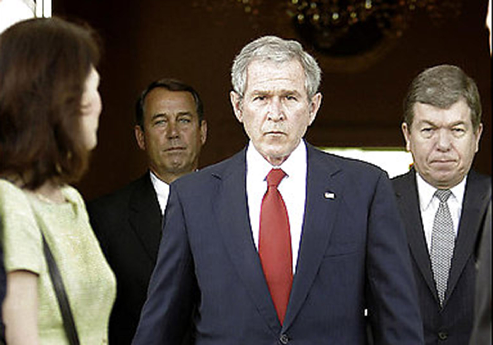 President Bush, center, flanked by House Minority Leader John Boehner of Ohio, left, and House Minority Whip Roy Blunt of Mo., walks out to the North Portico of the White House in Washington, Thursday, March 29, 2007. (AP Photo/Pablo Martinez Monsivais)