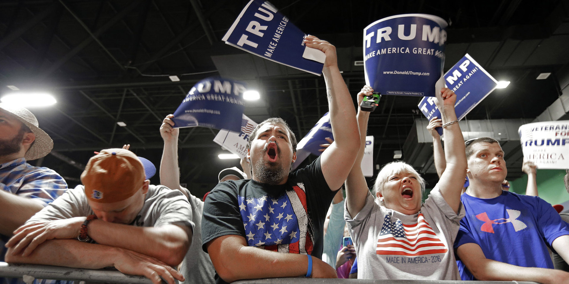 Supporters cheer for Republican presidential candidate Donald Trump during a campaign rally at the Greensboro Coliseum in Greensboro, N.C., Tuesday, June 14, 2016. (AP Photo/Chuck Burton)