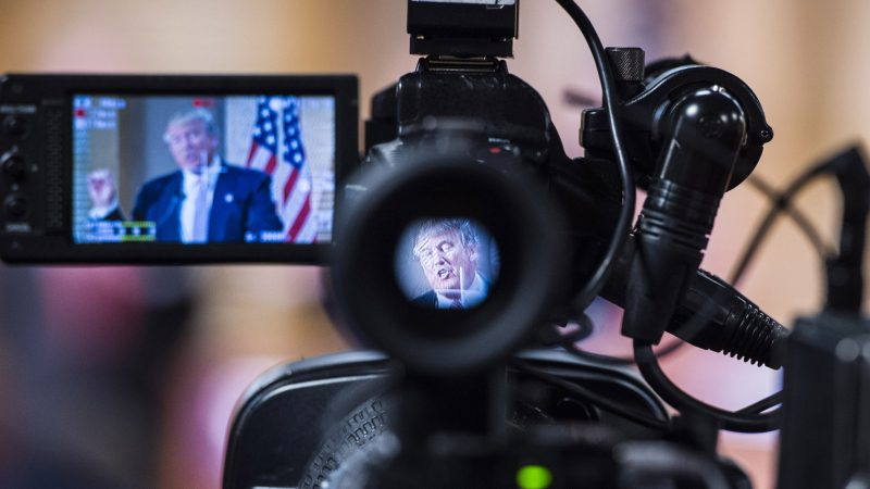 HANAHAN, SC - FEBRUARY 15: Republican presidential candidate Donald Trump is seen speaking through a camera at a press conference at the City of Hanahan town hall in Hanahan, SC on Monday Feb. 15, 2016. (Photo by Jabin Botsford/The Washington Post via Getty Images)